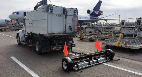 Piranha magnet cleaning up FOD on runway