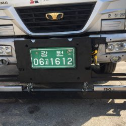 ISO hanging magnetic sweeper on South Korean highway maintenance truck